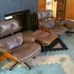 2 Taupe Eames Loungers with ottoman