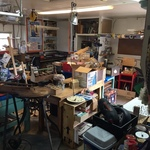 packed garage with small hand tools and crafting, antique jigsaw