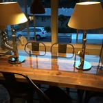reclaimed wood table & Philippe Starck lamps